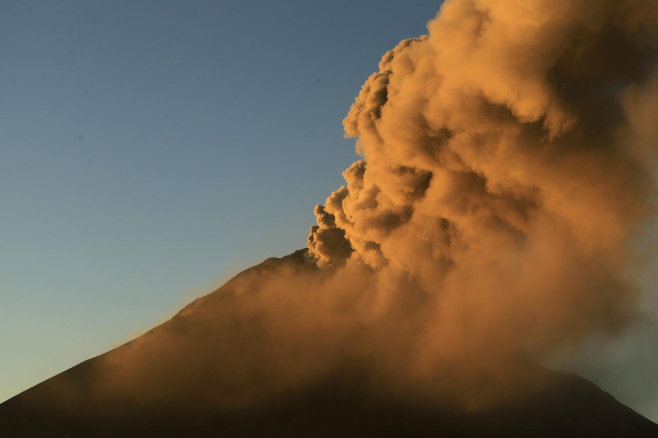 Ash and steam billow from the Tungurahua volcano, seen from Huambalo, Ecuador, early Tuesday, Aug. 21, 2012. (AP Photo/Dolores Ochoa)