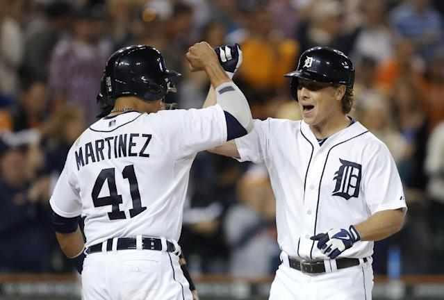 Detroit Tigers' Andy Dirks, right, is congratulated for his three-run home run by Victor Martinez (41) during the ninth inning of a baseball game against the Chicago White Sox in Detroit, Saturday, Sept. 21, 2013. (AP Photo/Carlos Osorio)