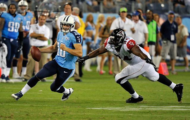 NASHVILLE, TN - AUGUST 24: Quarterback Jake Locker #10 of the Tennessee Titans scrambles past Peria Jerry #94 of the Atlanta Falcons at LP Field on August 24, 2013 in Nashville, Tennessee. (Photo by Frederick Breedon/Getty Images)