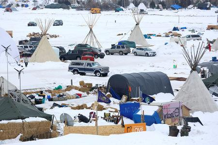 FILE PHOTO: Signs hang in the Dakota Access Pipeline protest camp on the edge of the Standing Rock Sioux Reservation near Cannon Ball