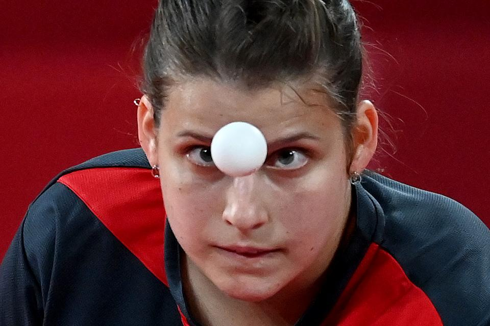 <p>Germany's Petrissa Solja competes during her women's team semifinal table tennis match at the Tokyo Metropolitan Gymnasium during the Tokyo 2020 Olympic Games in Tokyo on August 4, 2021. (Photo by ADEK BERRY / AFP)</p>
