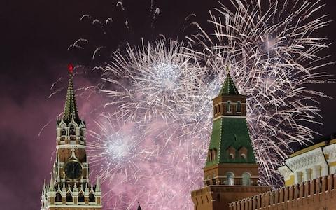 <span>Fireworks light the night sky over the Kremlin and the Red square to mark the New Year in Moscow</span> <span>Credit: Rex </span>