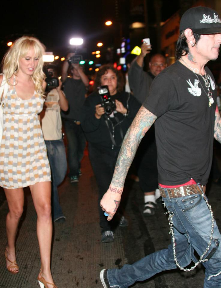 "Tommy clears the way for Kimberly. Couldn't he at least hold her hand? Rodrigo Marques/<a href=""http://www.splashnewsonline.com/"" target=""new"">Splash News</a> - July 17, 2007"