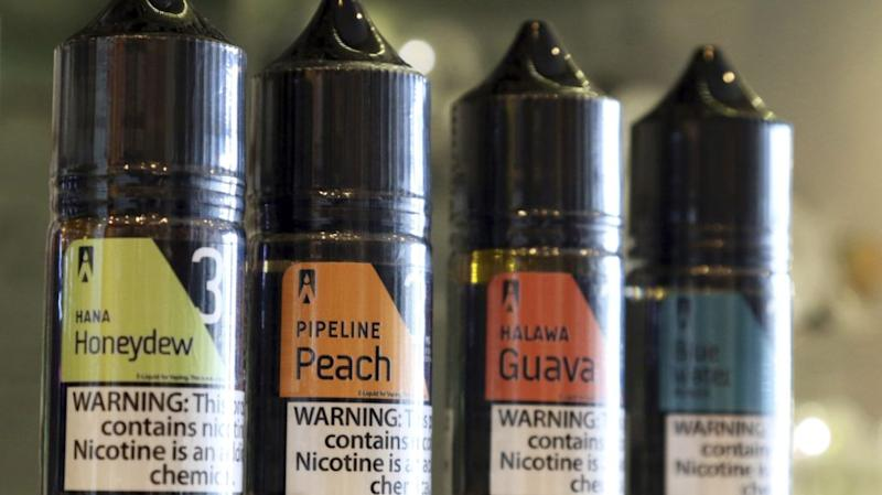 Four flavored e-cigarette cartridges, all with sweet flavors an brightly colored packaging. Flavors include melon, peach, guava, and cookie monsta