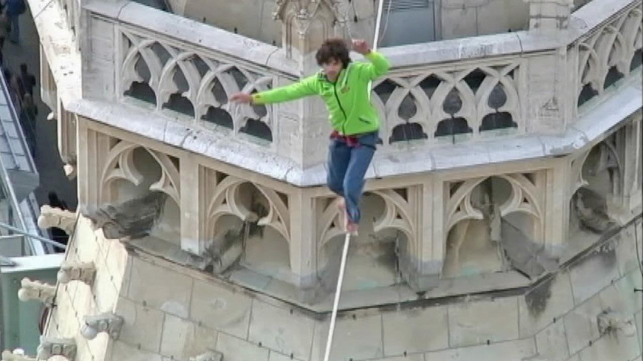 A daredevil became the first man to walk a tightrope strung between the two towers of St. Stephen's Cathedral.