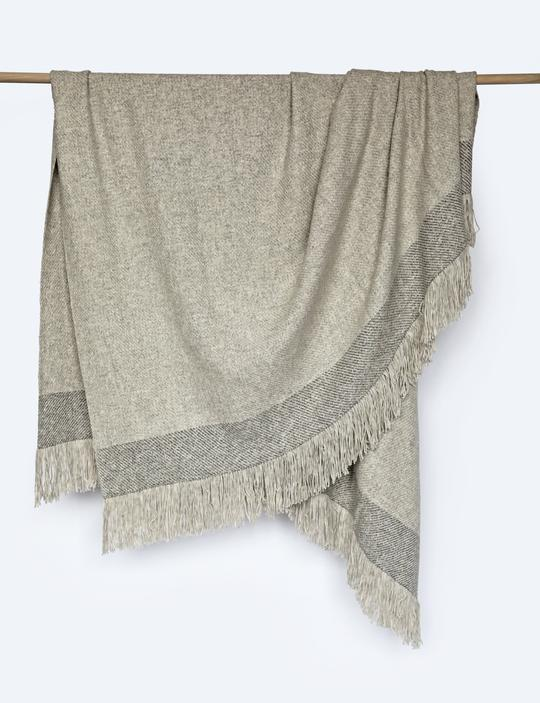 """This luxurious throw blanket, handwoven in Peru, is made from organic cotton and baby alpaca wool. $198, Coterie Brooklyn. <a href=""""https://coteriebrooklyn.com/collections/throws/products/alpaca-color-block-throw-blanket-dove-and-grey"""" rel=""""nofollow noopener"""" target=""""_blank"""" data-ylk=""""slk:Get it now!"""" class=""""link rapid-noclick-resp"""">Get it now!</a>"""