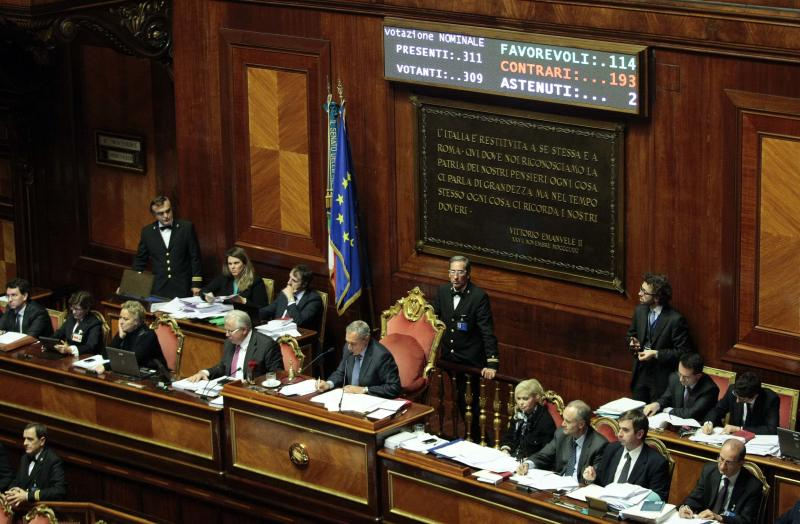A screen displays the vote as the Senate speaker Grasso declares Berlusconi was ineligible for a seat in parliament after the house rejected a series of challenges by Berlusconi's supporters to a proposal for his expulsion at the Senate in Rome