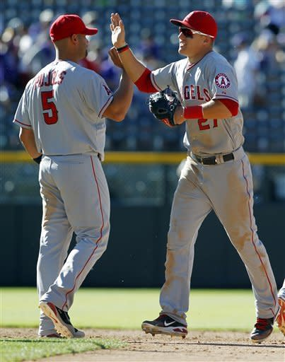 Los Angeles Angels first baseman Albert Pujols, left, celebrates with center fielder Mike Trout after their 11-5 victory over the Colorado Rockies in a baseball game in Denver, Saturday, June 9, 2012. (AP Photo/David Zalubowski)