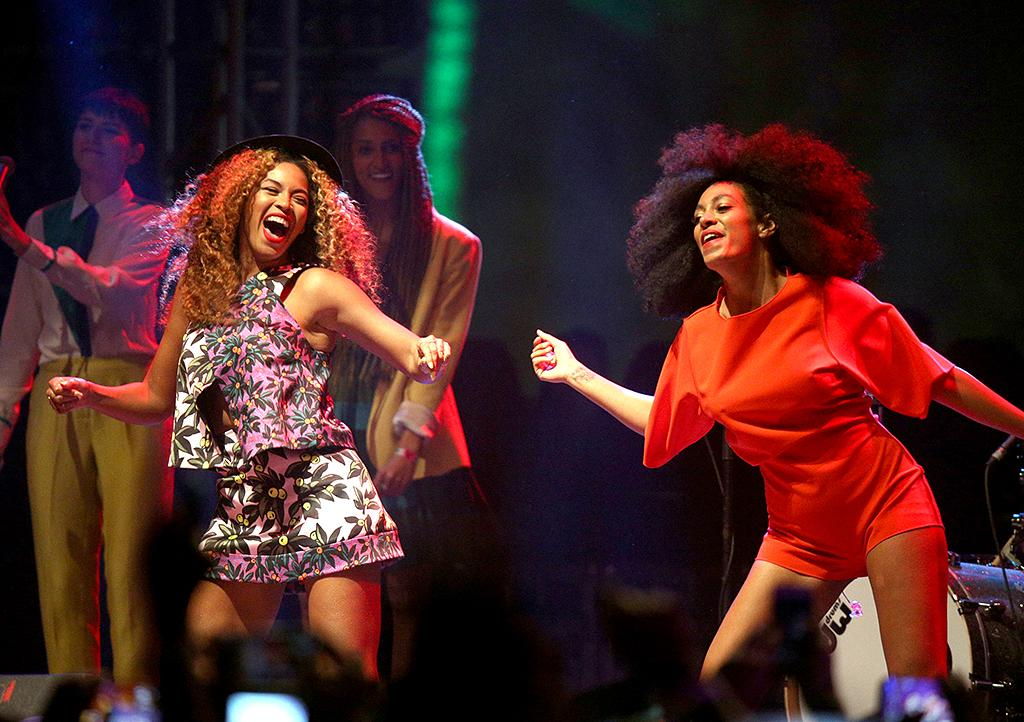 <p>Beyoncé (L) and Solange perform onstage during day 2 of the 2014 Coachella Valley Music & Arts Festival at the Empire Polo Club on April 12, 2014 in Indio, California. (Photo: Imeh Akpanudosen/Getty Images for Coachella) </p>