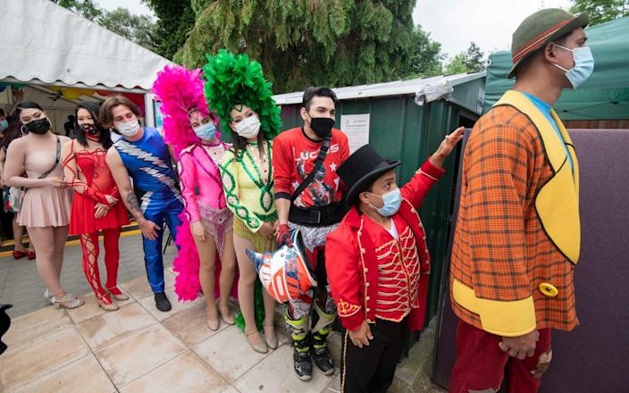 Members of the touring Zippo Circus attend a vaccination clinic in Finchley, North London
