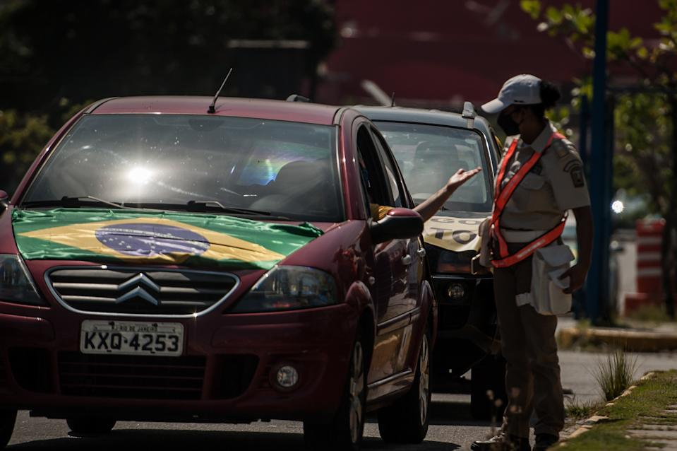 Drivers are seen during an act called ''Carreata in defense of lava jet'' in the neighborhood of Barra da tijuca, west of the city of Rio de Janeiro, on September 06, 2020. The demonstration aims to provide support to the investigations of the federal police's lava jet operation, where the protesters leave in a motorcade in the district of Barra da Tijuca and head towards Leme located in the south of the city.(Photo by Allan Carvalho/NurPhoto via Getty Images)