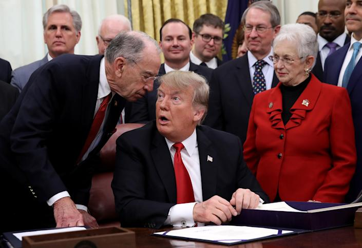 "<span class=""s1"">Sen. Chuck Grassley tells President Trump he needs to leave to cast a vote in the Senate during the signing ceremony for the First Step Act on Dec. 21. Grassley said he had not missed a vote since 1993. (Photo: Win McNamee/Getty Images)</span>"