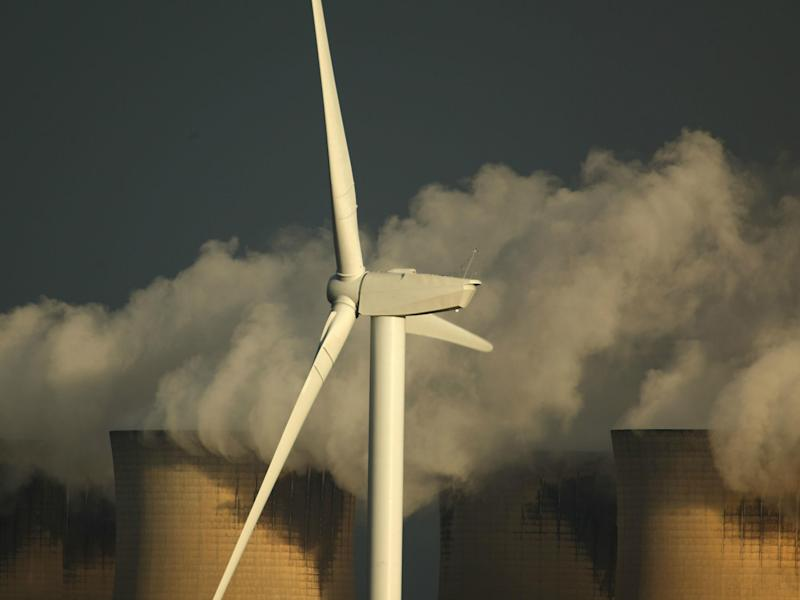 Wind turbines generate electricty in the shadow of Drax, Europe's second biggest coal-fired power station: Getty