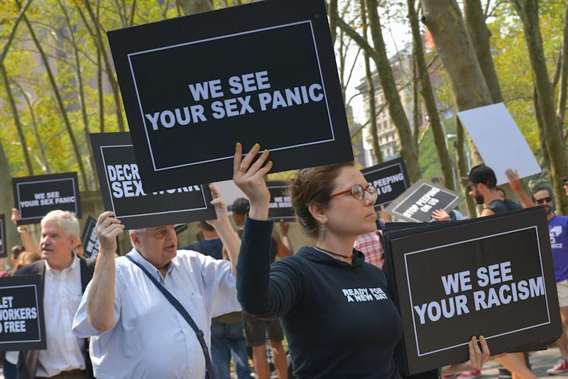 Activists from the LGBTQ community held a rally outside the federal courthouse in Brooklyn on Aug. 25, 2015, to protest a raid on a male escort service site.