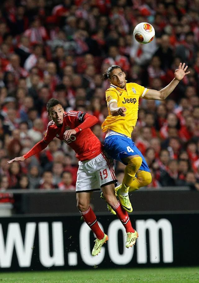 Juventus' Martin Caceres, right, jumps for the ball with Benfica's Rodrigo during the Europa League semifinal, first leg, soccer match between Benfica and Juventus Thursday, April 24 2014, at Benfica's Luz stadium in Lisbon. (AP Photo/Armando Franca)