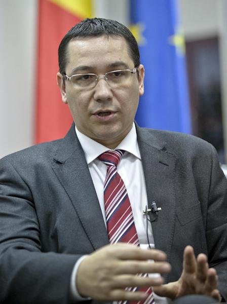 Romanian Premier Victor Ponta speaks during an interview with the Associated Press in Bucharest, Romania, Wednesday, Dec. 12, 2012. Romania's prime minister says he is confident the president will reappoint him after a weekend election victory despite a bitter power struggle between the two that has raised fears of a standoff. (AP Photo/Vadim Ghirda)