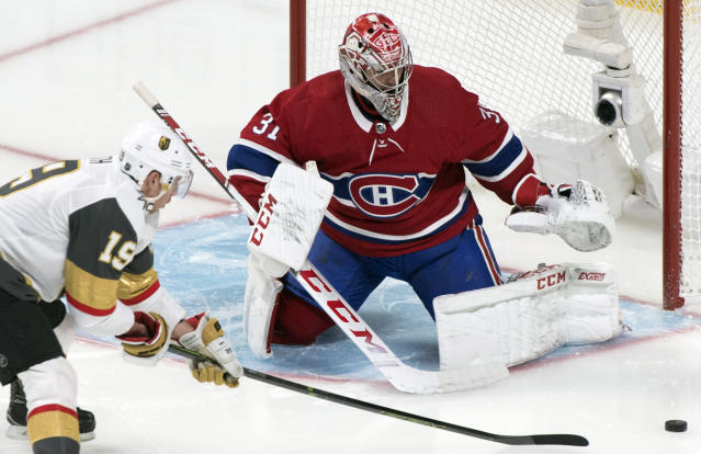 Vegas Golden Knights' Reilly Smith, left, moves in against Montreal Canadiens goaltender Carey Price during first-period NHL hockey game action in Montreal, Saturday, Jan. 18, 2020. (Graham Hughes/The Canadian Press via AP)