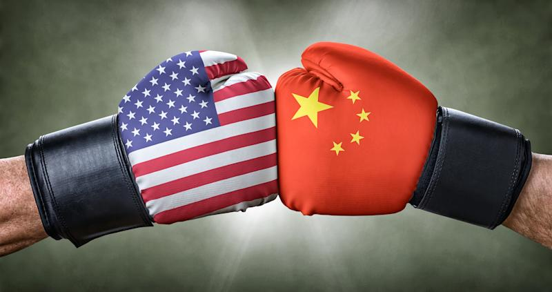 Two boxing gloves adorned with the American and Chinese flags