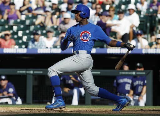 Chicago Cubs' Alfonso Soriano grounds out to drive in a run against the Colorado Rockies in the ninth inning of the Rockies' 4-3 victory in a baseball game in Denver, Sunday, July 21, 2013. (AP Photo/David Zalubowski)