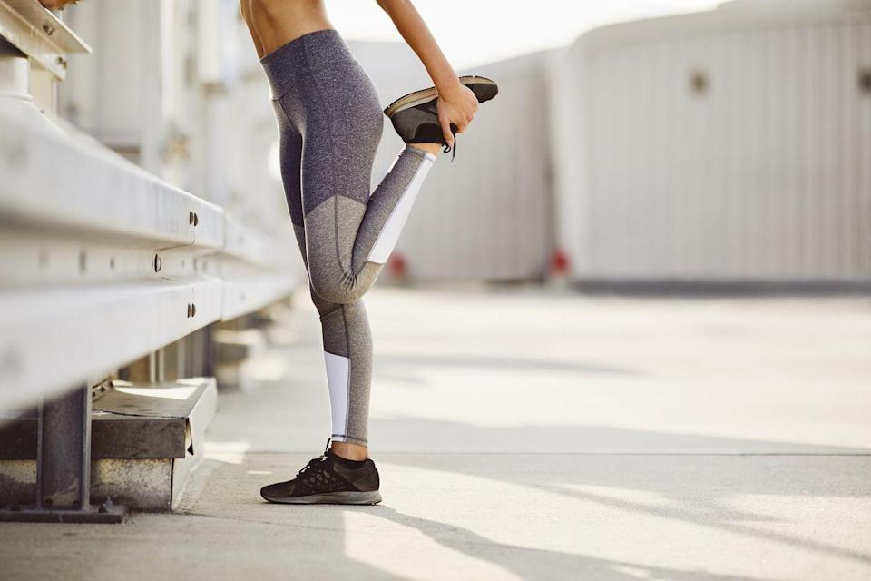 """<p>Most of us learned how to warm up many years ago in elementary or middle school P.E. classes. Much of that is now out-of-date. Today, research indicates that static stretching is not the best for a runner. In fact, <a href=""""http://www.runnersworld.com/sweat-science/should-you-stretch-before-running"""" rel=""""nofollow noopener"""" target=""""_blank"""" data-ylk=""""slk:one study"""" class=""""link rapid-noclick-resp"""">one study</a> found that static stretching before a run led to slower starts and a greater perceived effort. Other studies show that even the simple sit-and-reach stretch can <a href=""""http://link.springer.com/article/10.1007/s00421-011-1879-2"""" rel=""""nofollow noopener"""" target=""""_blank"""" data-ylk=""""slk:decrease your ability to stride naturally"""" class=""""link rapid-noclick-resp"""">decrease your ability to stride naturally</a>.</p><p>Instead, a dynamic warmup prepares your muscles more effectively. Static stretching for 30 to 60 seconds lengthens the muscle, but in doing so it also affects the signals between the muscle and the brain, triggering a protective reflex that prevents the muscle from being overstretched. Therefore, muscles become inhibited and are not able to contract as forcefully. This reflex decreases the strength and power of the muscle for a short time afterwards.</p><p>A dynamic warmup refers to moving your muscles through a wide range of motion that simulates the running movement. Think of it as lubricating your joints before a run. </p><p><strong>RELATED: </strong><a href=""""https://www.womenshealthmag.com/uk/fitness/workouts/a707724/warmup-dynamic-streches/"""" rel=""""nofollow noopener"""" target=""""_blank"""" data-ylk=""""slk:4 warm-up stretches to do before every workout"""" class=""""link rapid-noclick-resp"""">4 warm-up stretches to do before every workout</a></p>"""