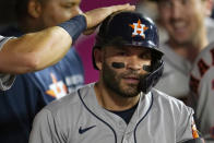 Houston Astros' Jose Altuve gets a pat on his helmet after hitting a two-run home run during the fifth inning of a baseball game against the Los Angeles Angels Tuesday, Sept. 21, 2021, in Anaheim, Calif. (AP Photo/Marcio Jose Sanchez)