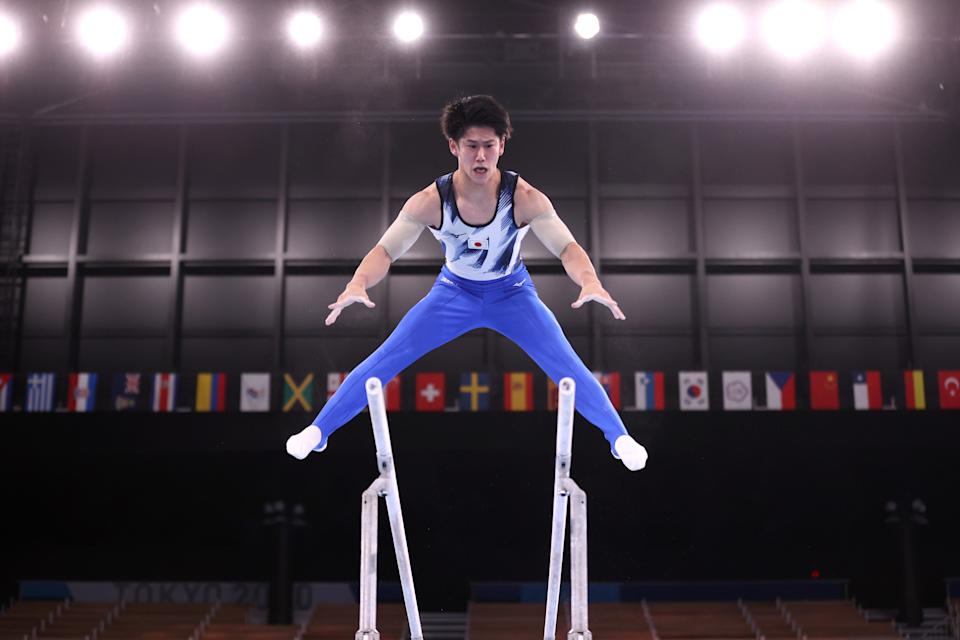 <p>TOKYO, JAPAN - JULY 28: Daiki Hashimoto of Team Japan competes on parallel bars during the Men's All-Around Final on day five of the Tokyo 2020 Olympic Games at Ariake Gymnastics Centre on July 28, 2021 in Tokyo, Japan. (Photo by Laurence Griffiths/Getty Images)</p>