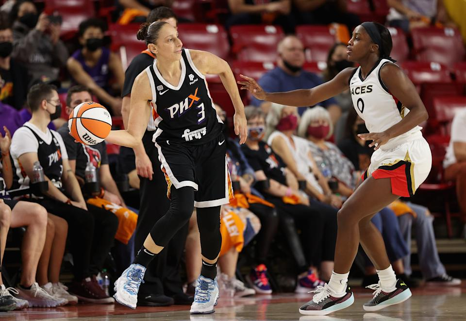 Phoenix's Diana Taurasi attempts to pass the ball around Las Vegas' Jackie Young Game 3 of the 2021 WNBA semifinals at Arizona State's Desert Financial Arena in Tempe, Arizona, on Oct. 3, 2021. (Christian Petersen/Getty Images)