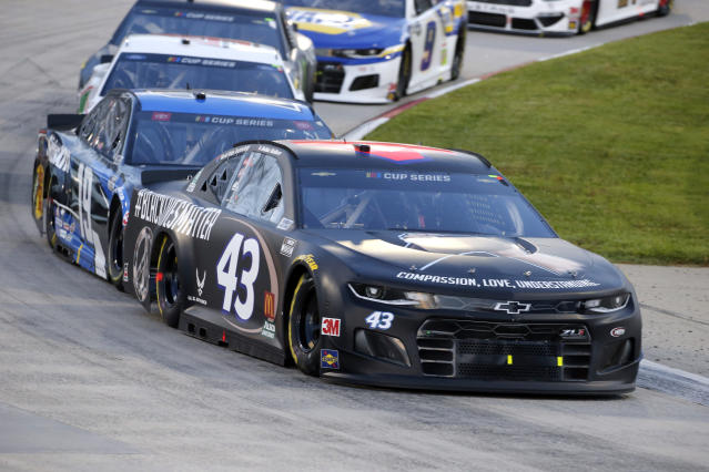 Bubba Wallace (43) drives during a NASCAR Cup Series auto race Wednesday, June 10, 2020, in Martinsville, Va. (AP Photo/Steve Helber)