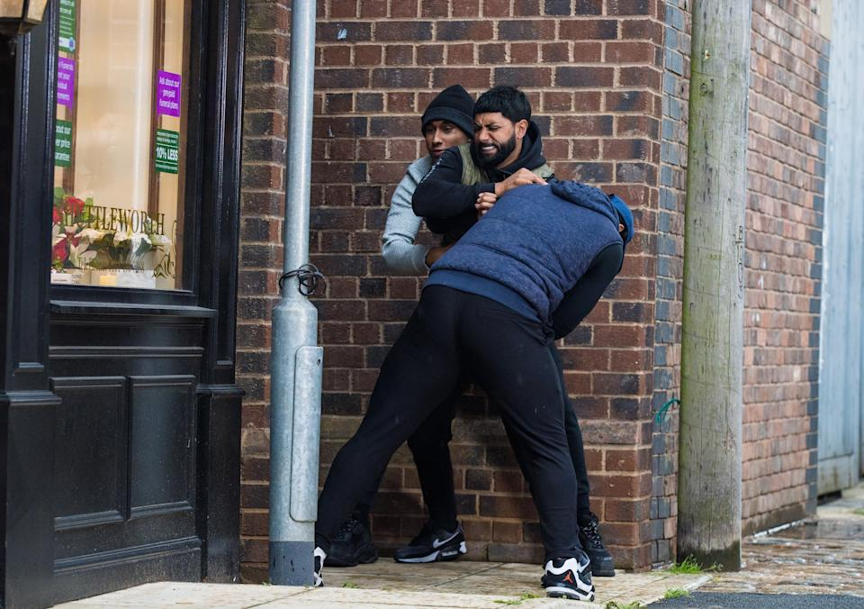 FROM ITV  STRICT EMBARGO - No Use Before  Tuesday 14th September  2021  Coronation Street - Ep 10434  Monday 20th September 2021 - 1st Ep   Outside Speed Daal, two thugs grab Zeedan Nazir [QASIM AHKTAR]. Elaine Metcalfe [PAULA WILCOX] and Cathy Matthews [MELANIE HILL] are horrified to discover Zeedan slumped in the ginnel, battered and bleeding.  Picture contact David.crook@itv.com   Photographer - Danielle Baguley  This photograph is (C) ITV Plc and can only be reproduced for editorial purposes directly in connection with the programme or event mentioned above, or ITV plc. Once made available by ITV plc Picture Desk, this photograph can be reproduced once only up until the transmission [TX] date and no reproduction fee will be charged. Any subsequent usage may incur a fee. This photograph must not be manipulated [excluding basic cropping] in a manner which alters the visual appearance of the person photographed deemed detrimental or inappropriate by ITV plc Picture Desk. This photograph must not be syndicated to any other company, publication or website, or permanently archived, without the express written permission of ITV Picture Desk. Full Terms and conditions are available on  www.itv.com/presscentre/itvpictures/terms