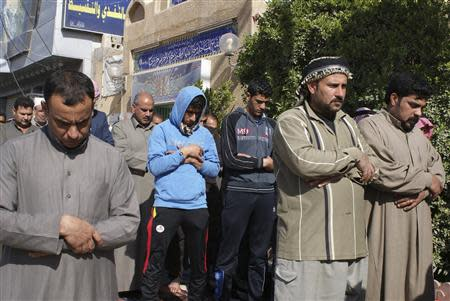 Sunni Muslims attend Friday prayers in the city of Falluja