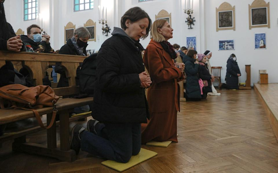 Vera Golubovich (left) goes to opposition protests every Sunday after mass with her friend Yelena Lido (right) - Maxim Sarychau/The Telegraph