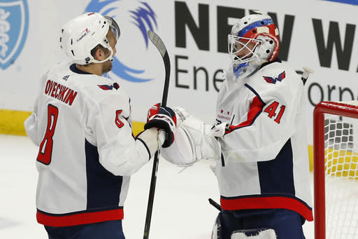 Washington Capitals Goalie Vitek Vanecek (41) celebrates his first NHL victory with forward Alex Ovechkin (8) following the third period of a hockey game against the Buffalo Sabres, Friday, Jan. 15, 2021, in Buffalo, N.Y. (AP Photo/Jeffrey T. Barnes)