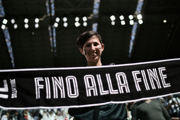 "A Juventus fan displays a scarf reading ""Until the end"" prior to the Women's Serie A football match against Fiorentina"