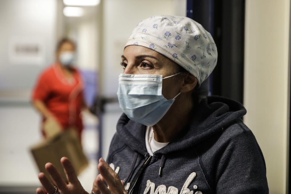 Nurse Cristina Settembrese talks during an interview with the Associated Press outside the intensive care unit after finishing a night shift, at the San Paolo hospital, in Milan, Italy, Thursday, Oct. 15, 2020. (AP Photo/Luca Bruno)