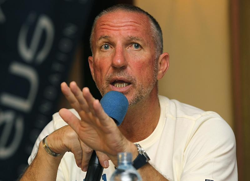 Former England cricketer Sir Ian Botham addresses a press conference in Colombo on March 27, 2011