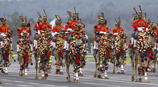 Pakistan army musical band parade on camelback during a military parade to mark Pakistan National Day, in Islamabad, Pakistan, Saturday, March 23, 2019. Pakistanis are celebrating their National Day with a military parade that's showcasing short- and long-range missiles, tanks, jets, drones and other hardware. (AP Photo/Anjum Naveed)