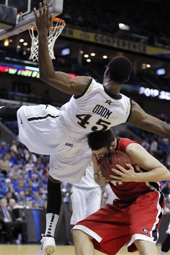 Vanderbilt forward Rod Odom (45) flips over backwards over Georgia center John Cannon (41) during the first half of an NCAA college basketball game in the second round of the Southeastern Conference tournament at the New Orleans Arena in New Orleans, Friday, March 9, 2012. (AP Photo/Bill Haber)