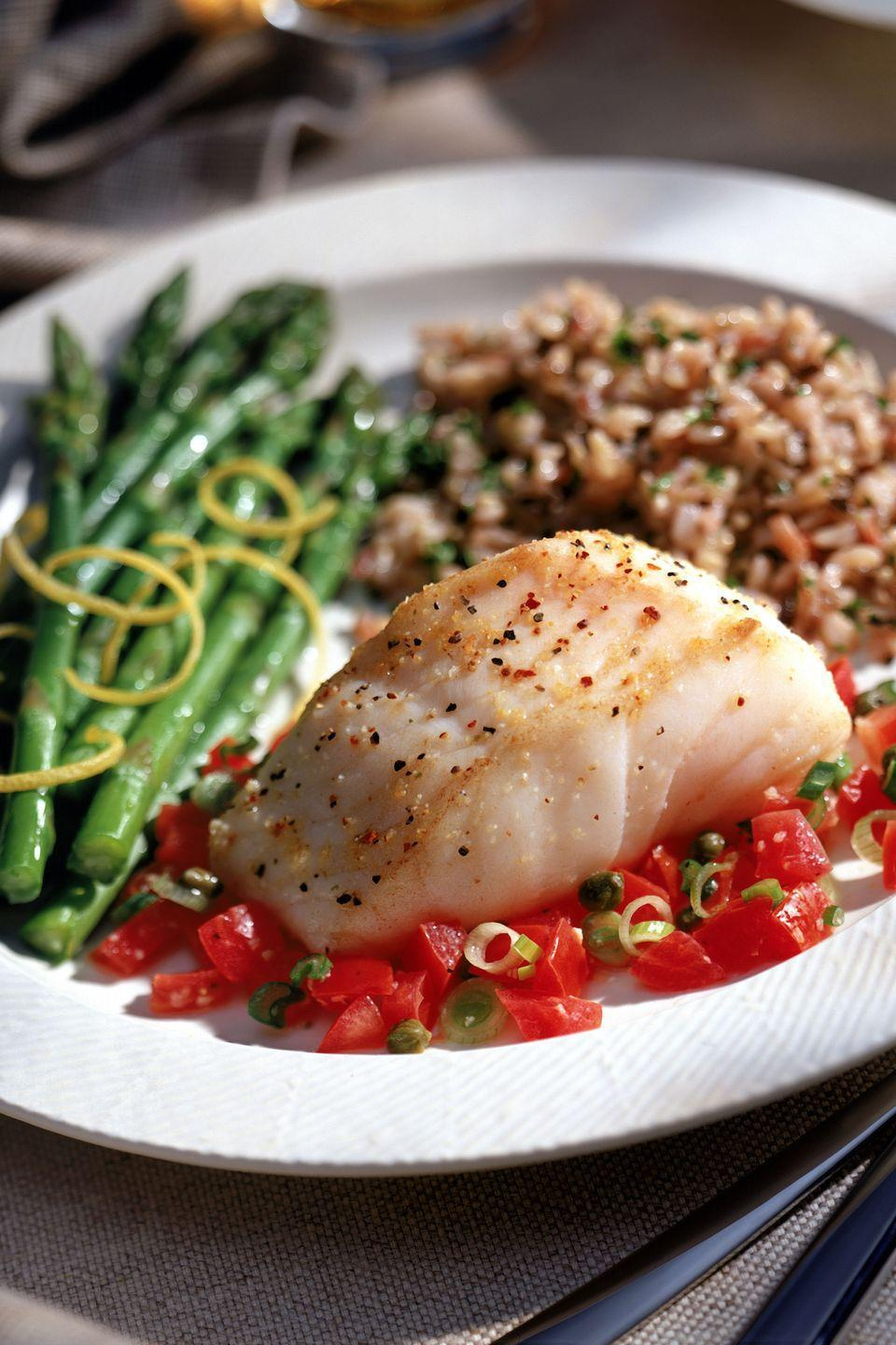"<p>Serve 4 ounces broiled <a href=""https://www.goodhousekeeping.com/food-recipes/a42845/lemon-herb-baked-flounder-recipe/"" rel=""nofollow noopener"" target=""_blank"" data-ylk=""slk:flounder"" class=""link rapid-noclick-resp"">flounder</a> or sole with 2 sliced plum tomatoes sprinkled with 2 tablespoons grated Parmesan cheese, broiled until just golden. Eat with 1 cup cooked couscous and 1 cup steamed broccoli. Enjoy with a single-serve ice cream (like <a href=""https://www.goodhousekeeping.com/food-products/ice-cream-reviews/g22607515/healthy-ice-creams/"" rel=""nofollow noopener"" target=""_blank"" data-ylk=""slk:any of these delicious picks"" class=""link rapid-noclick-resp"">any of these delicious picks</a>!) for dessert. </p>"