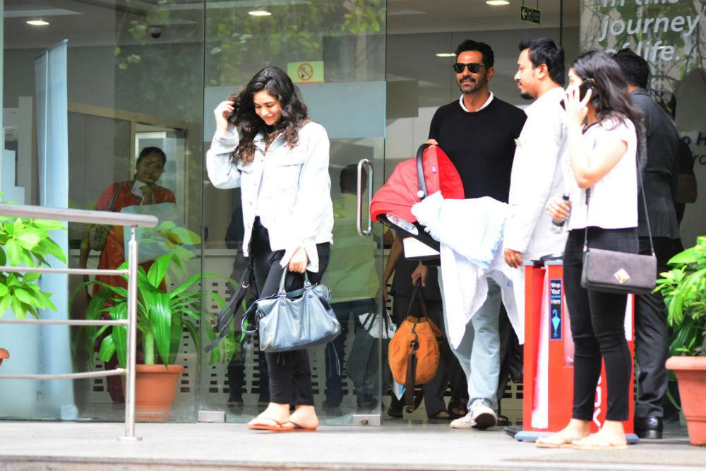 Arjun Rampal and Gabriella Demetriades with their baby boy