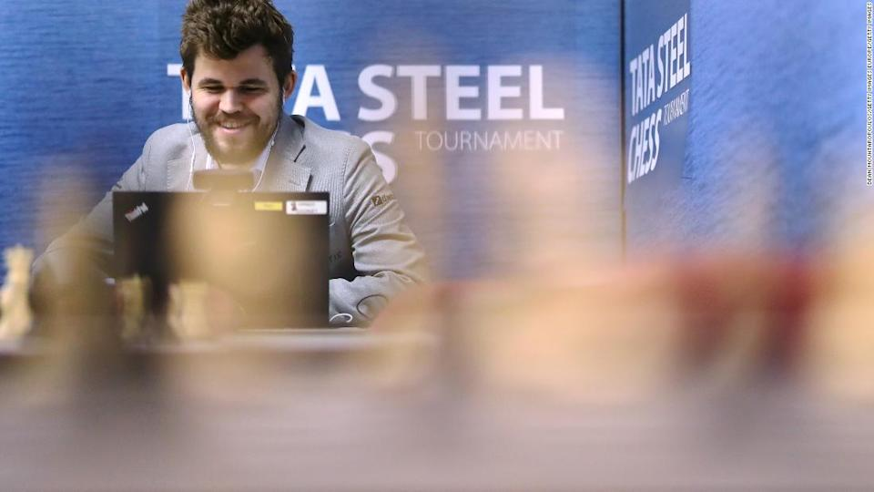 """<p>Carlsen speaks on his computer in the press room after he competes against Wesley So.</p><div class=""""cnn--image__credit""""><em><small>Credit: Dean Mouhtaropoulos/Getty Images Europe/Getty Images / Getty Images</small></em></div>"""