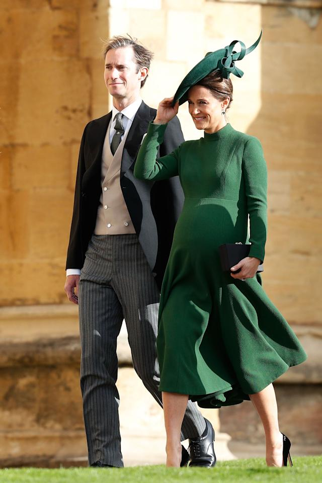 "<p>In a dark green, midi length, long sleeve dress with mock-turtleneck detail arriving at at <a rel=""nofollow"" href=""https://www.harpersbazaar.com/celebrity/latest/a15836773/princess-eugenie-wedding-date-location-facts/"">Princess Eugenie's wedding</a> to Jack Brooksbank at St. George's Chapel at Windsor Castle. </p>"