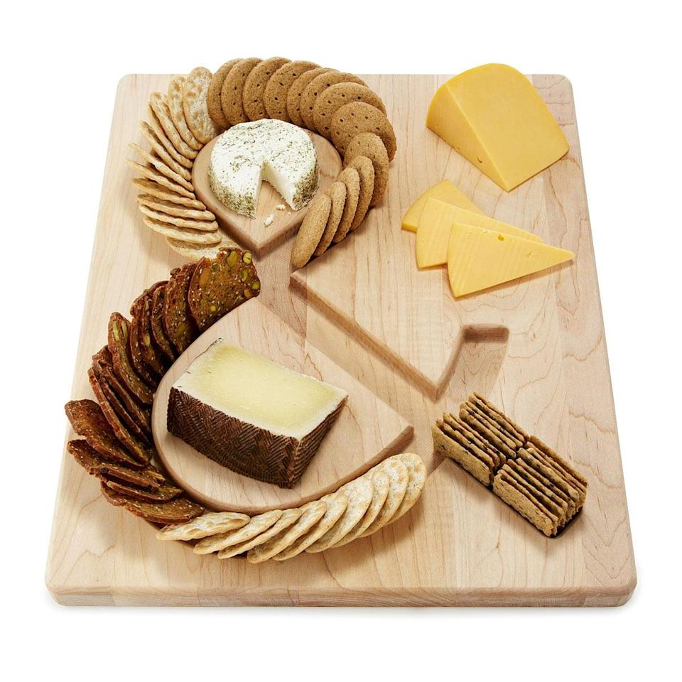 <p>This <span>Ampersand Cheese and Crackers Board</span> ($48) combines two of our favorite things: literature and snacks.</p>