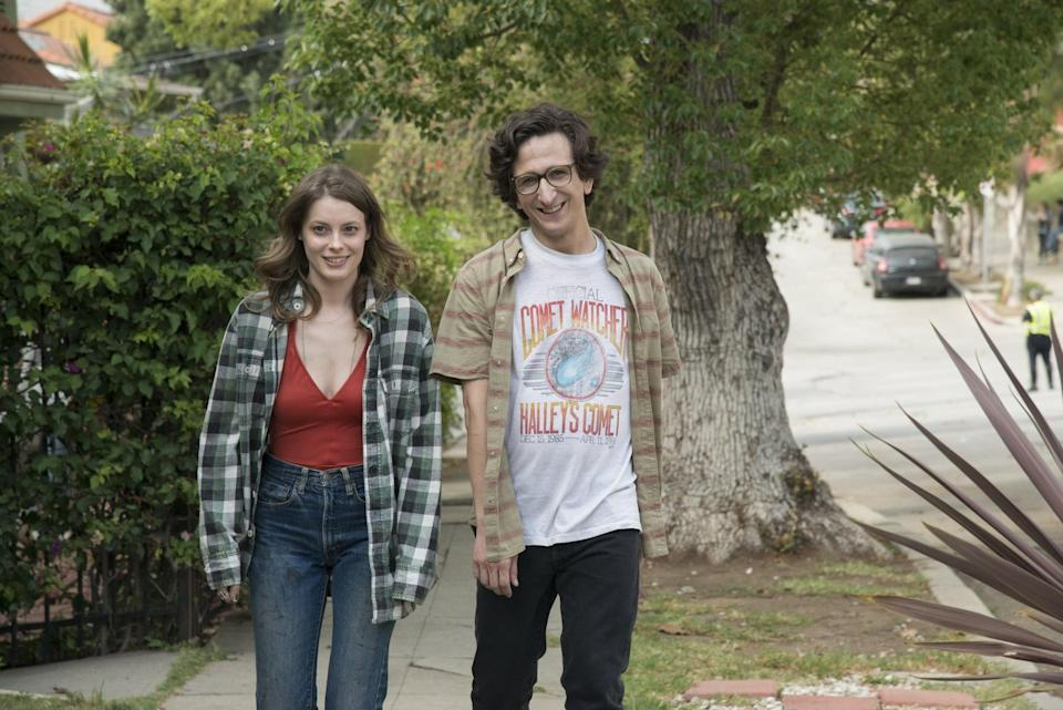 <p><strong>For Mickey:</strong> An oversize, unbuttoned plaid shirt, with a red bodysuit tucked into high-waisted jeans.</p> <p><strong>For Gus:</strong> Thick-rimmed glasses, a band t-shirt, and a short-sleeved plaid shirt with jeans.</p>