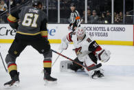 Arizona Coyotes goaltender Darcy Kuemper (35) makes a save against Vegas Golden Knights right wing Mark Stone (61) during the second period of an NHL hockey game Friday, Nov. 29, 2019, in Las Vegas. (AP Photo/John Locher)