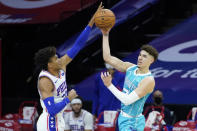 Charlotte Hornets' LaMelo Ball, right, passes against Philadelphia 76ers' Matisse Thybulle during the second half of an NBA basketball game, Saturday, Jan. 2, 2021, in Philadelphia. (AP Photo/Matt Slocum)