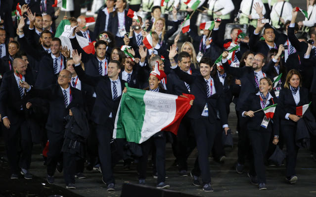 Italy's athletes wave to spectators as they parade during the Opening Ceremony at the 2012 Summer Olympics, Friday, July 27, 2012, in London. (AP Photo/Jae C. Hong)