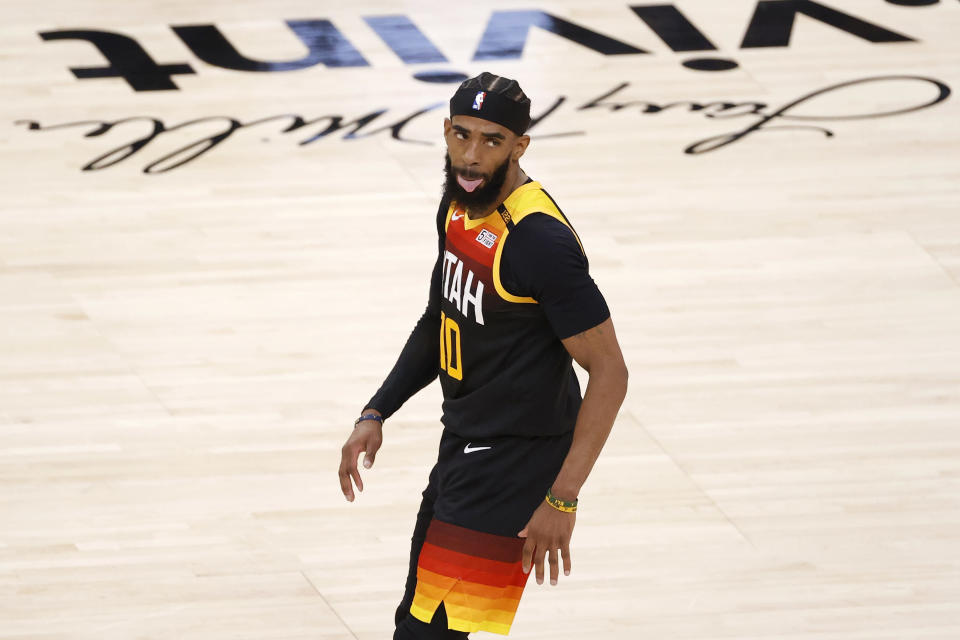 Mar 29, 2021; Salt Lake City, Utah, USA; Utah Jazz guard Mike Conley (10) reacts after making a three-pointer in the third quarter against the Cleveland Cavaliers at Vivint Smart Home Arena.