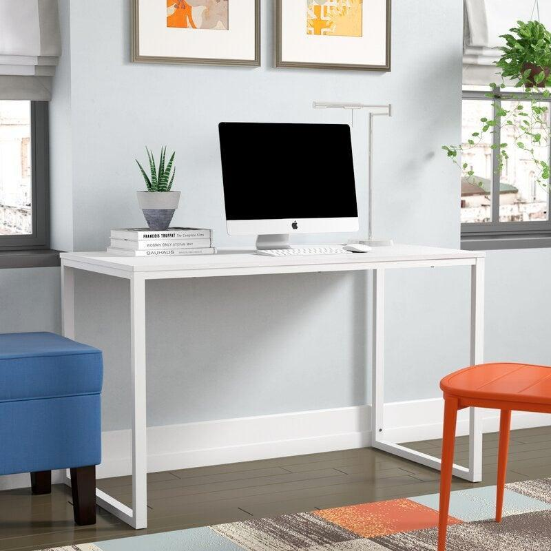 """<h3>Most Wanted Desks</h3><br><h2>Wade Logan Colburn Desk</h2><br><strong>Deal: 34% off</strong><br>This desk fits almost any office, is easy to assemble, and most importantly, is under $100. Desks were all the rage last year once the pandemic hit, and now we're hooked on having a solidified WFH space even with the world opening back up.<br><br><em>Shop</em> <strong><em><a href=""""https://www.wayfair.com/brand/bnd/wade-logan-b36989.html"""" rel=""""nofollow noopener"""" target=""""_blank"""" data-ylk=""""slk:Wade Logan"""" class=""""link rapid-noclick-resp"""">Wade Logan</a></em></strong><br><br><br><strong>Wade Logan</strong> Colburn Desk, $, available at <a href=""""https://go.skimresources.com/?id=30283X879131&url=https%3A%2F%2Fwww.wayfair.com%2Ffurniture%2Fpdp%2Fwade-logan-colburn-desk-w001275572.html"""" rel=""""nofollow noopener"""" target=""""_blank"""" data-ylk=""""slk:Wayfair"""" class=""""link rapid-noclick-resp"""">Wayfair</a>"""