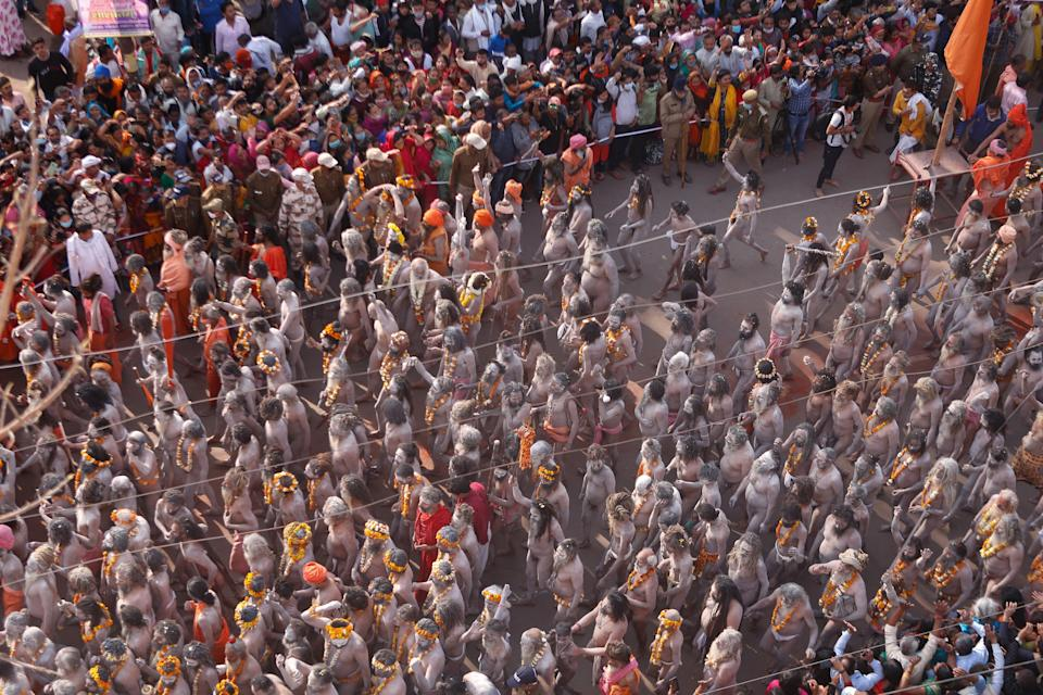 naga Sadhus or holy men of Juna Akhara move towards ganges River to take a holy dip on the occasion of first royal bath of Shivratri festival during Maha Kumbh Festival , in Haridwar on March 11, 2021 . (Photo by Ritesh Shukla/NurPhoto via Getty Images)