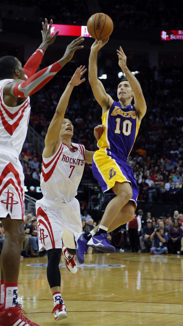 Los Angeles Lakers' Steve Nash (10) goes up for a shot as Houston Rockets' Jeremy Lin (7) and Dwight Howard, left, defend during the first quarter of an NBA basketball game Thursday, Nov. 7, 2013, in Houston. (AP Photo/David J. Phillip)